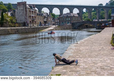 Dinan, France - August 26, 2019: Port Of Dinan And Viaduct Of Lanvallay Over The Rance River In Fren