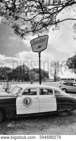 Fredericksburg,texas - Nov. 12, 2020   Old Antique 1950  Hudson Police Car Parked Next To 1950's Sin