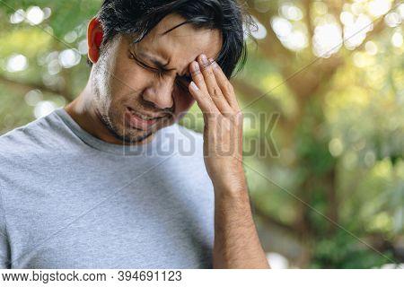 Man Having Strong Headache, Feeling Pain, Young Asian Man Has A Headache