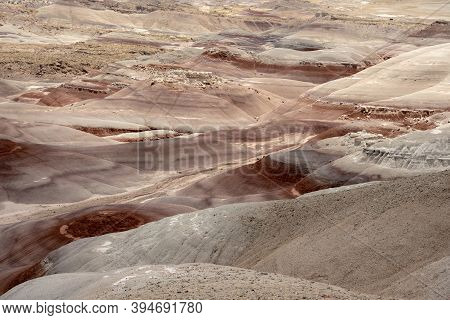 Red And Tan Bentonite Hills Spanning Across Desert Wilderness