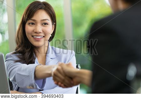 Photo Of Handshaking In A Personnel Office After Job Interview With Soft Focus On Attractive Asian Y