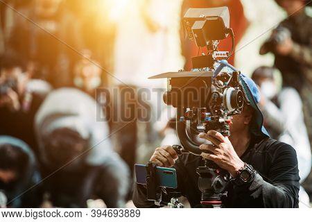 Cameraman Operating Camera Shooting With Cinema Camera
