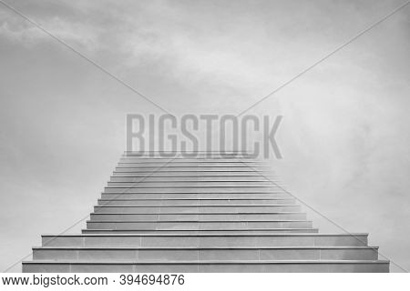 Abstract Image Of Front View Architecture Of Concrete Staircase Or Ladder Leading To Sky.