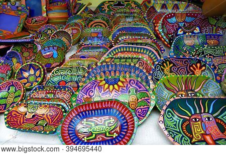 Andean Indigenous Culture Of Tigua, Cotopaxi. Souvenirs Plates Made Of Wood, Painted With Striking C