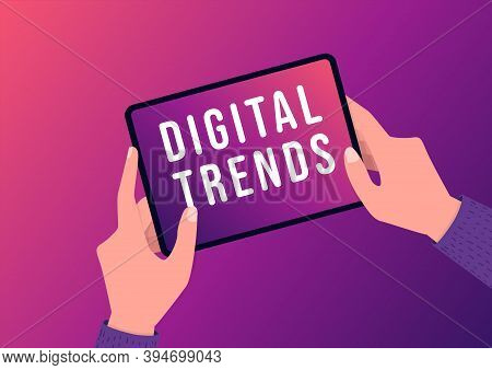 Hand Holding Tablet With Digital Trends Text On Screen. New Trends Digital Marketing, Business And T