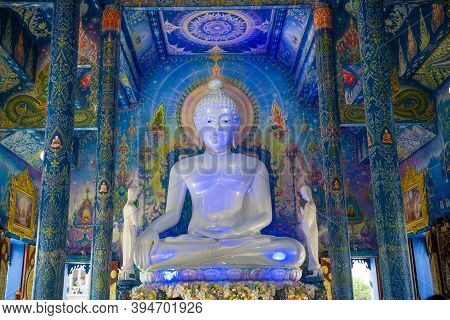 Chiang Ray, Thailand - December 17, 2018: White Sculpture Of A Seated Buddha Close-up. Buddhist Temp