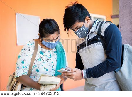University Students In Medical Mask Busy On Mobile Phone At College Corridor - Concept Of Students U