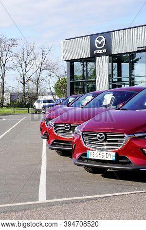 Bordeaux , Aquitaine / France - 11 11 2020 : Mazda Automobile Car Front Of Sign Logo Store Parked De