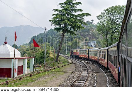 Shoghi,himachal Pradesh, India: April 14th, 2015- Narrow Gauge Shivalik Deluxe Express Train On Curv