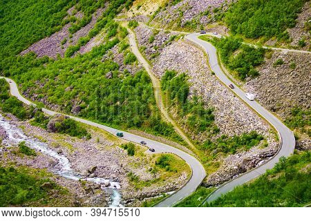 Trolls Path Trollstigen Winding Scenic Mountain Road With Cars, Norway Europe. National Tourist Rout