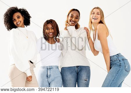 Group Of Four Happy Multiethnic Female Friends Looking At Camera. Portrait Of Young Women Of Differe