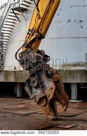 Hydraulic Shears On An Excavator Ready To Start Demolishing And Cutting Sheet Metal