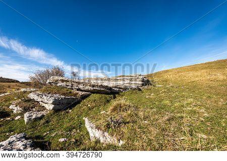 Karst Formations Rocks In Lessinia Plateau (altopiano Della Lessinia), Regional Natural Park In Vero