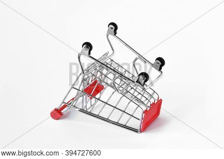 Empty Inverted Shopping Cart On White Background - Concept Of Shopping Cart Abandonment
