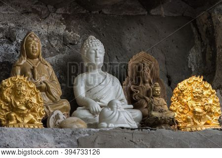 Statuettes Of Buddhist Deities At The Eight Great Temples Buddhist Complex In Badachu Park, Western