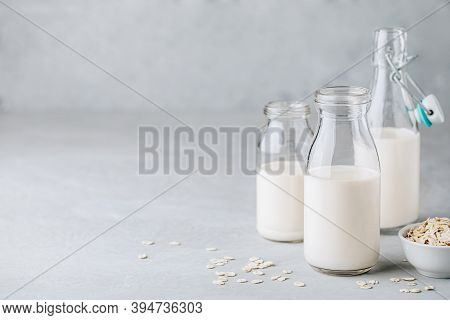 Oat Milk In Glass. Vegan Non Dairy Oat Milk On Gray Stone Background, Copy Space.