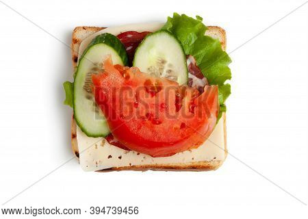 A Slice Of Toasted Toast, A Slice Of Cheese, A Lettuce Leaf, Two Slices Of Smoked Meat, Two Slices O