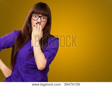 Portrait Of A Young Woman On A Yellow Background