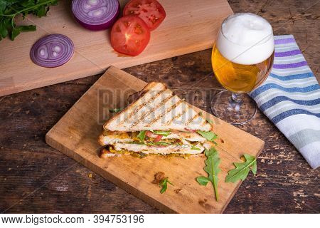 Tasty Triangular Sandwich Made From Toasted Bread With Chicken Breast, Fried Bacon, Vegetables, Pick