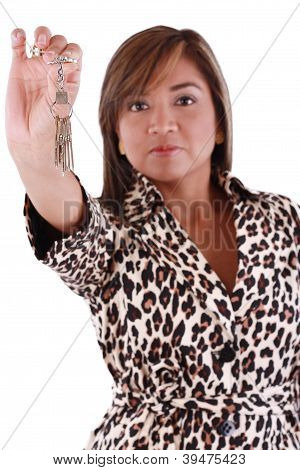 Portrait Of Business Woman With The Keys Isolated On White Background. Focus On Key