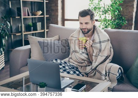 Photo Of Handsome Homey Guy Sit Comfy Sofa Saturday Weekend Drink Fresh Coffee Watch Film Notebook S