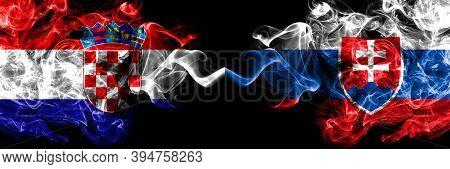 Croatia, Croatian Vs Slovakia, Slovakian Smoky Mystic Flags Placed Side By Side. Thick Colored Silky