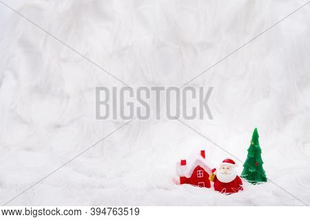 A Resin Or Ceramic Santa Claus Figure Standing Shaking A Bell Next To A Red House And A Cute Green C