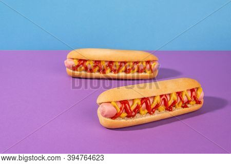 Couple Of Fresh Hot Dogs On Violet Background