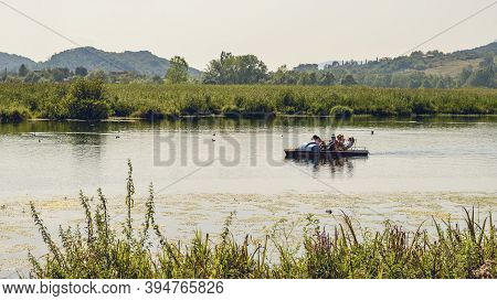 Posta Fibreno,frosinone,lazio,italy-august 14,2020:tourists On Pedal Boat By The Summer Lake Of Post