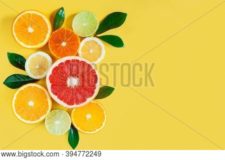 Slices Of Citruses Are Laid Out In Composition In Left Side Of Background. Pieces Of Tangerines, Ora