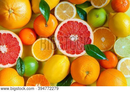 Slices, Pieces, Whole Ripe Citruses Are On Background. Juicy Tangerines, Oranges, Grapefruits, Lemon