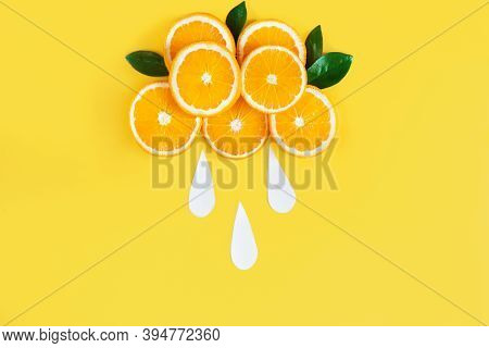 Cloud Is Laid Out Of Slices Of Juicy Oranges Is In Center Of Yellow Background. Summer Tropical Citr