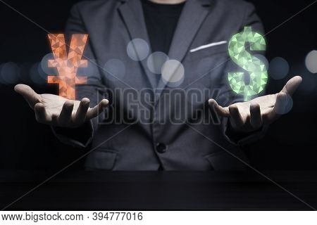 Businessman Holding Us Dollar Sign And Yuan Sign For Exchange Currency Concept. Dollar And Yuan Are