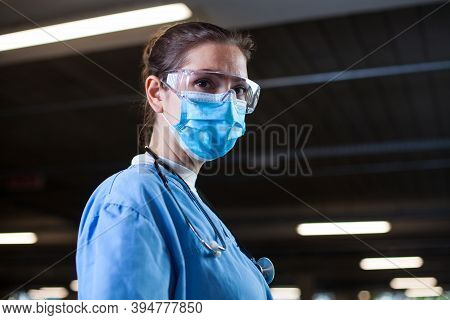 Young Female Uk Nhs Doctor In Lab Or Hospital Clinic,worried And Anxious,tired And Exhausted After L