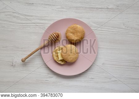 Homemade Flaky Buttermilk Biscuits On A Pink Plate On A White Wooden Table, Top View. Flat Lay, Over