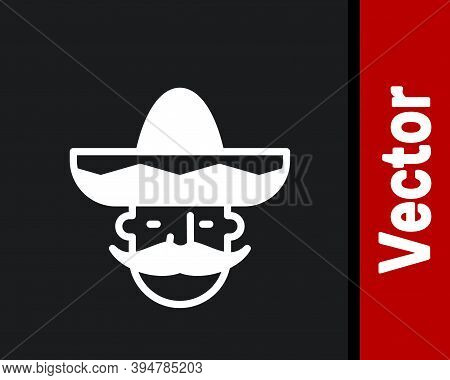 White Mexican Man Wearing Sombrero Icon Isolated On Black Background. Hispanic Man With A Mustache.