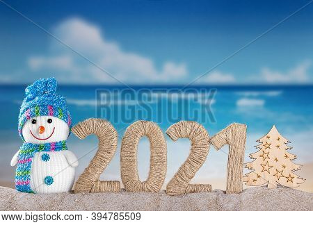 New Year 2021 And Snowman With Wooden Tree On Sea Background