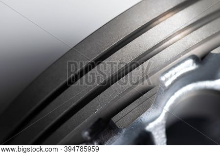 Close-up Piston Of An Internal Combustion Engine On A Gray Background. New Spare Parts For Engine Re