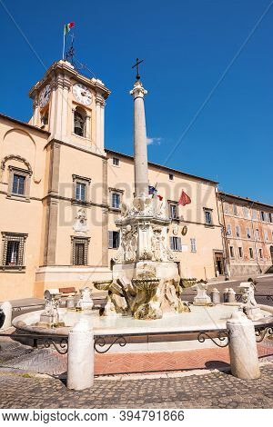Fountain And Town Hall In The Square Of Tarquinia (italy)