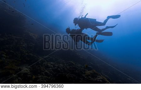 Underwater Photo Of Scuba Divers. From A Scuba Dive At Koh Haa In Thailand.