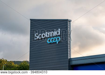 Drumnadrochit, Scotland - August 8, 2019: The Logo Of Scotmid Co-op Grocery Store On A Wall Of A Sho