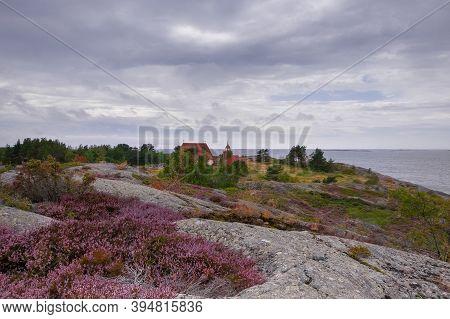 Finland, Aland Islands, Cökar, August - 2019: An Ancient Kircha But An Island Museum Among The Archi