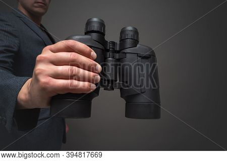 Businessman With A Binoculars In Hand. Searching Of New Ideas Concept.
