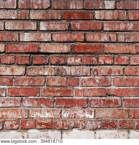 Grunge Red Brick Wall Background. Aged Wall Texture. Weathered Brickwork. Grungy Stonewall Backgroun