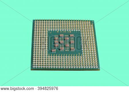 Photo Of A Cpu Chip Isolated Against The Background Of Aqua Menthol. Microprocessor, Central Process