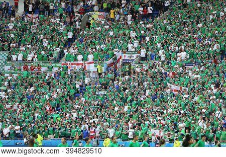 Lyon, France - June 16, 2016: Tribunes Of Stade De Lyon Stadium Crowded With Northern Ireland Fans D