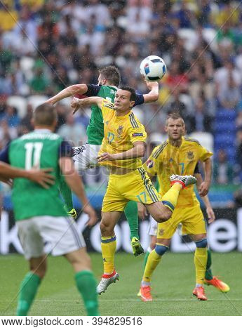 Lyon, France - June 16, 2016: Stuart Dallas Of Northern Ireland (l) Fights For A Ball With Artem Fed
