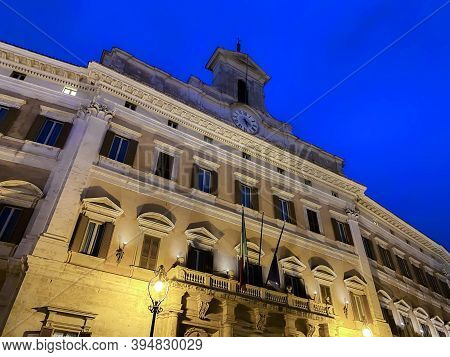 Night View Of Palazzo Montecitorio In Rome, Seat Of The Chamber Of Deputies Of The Italian Republic.