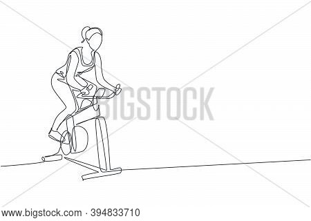Single Continuous Line Drawing Of Young Sportive Woman Training Endurance With Static Bike In Sport