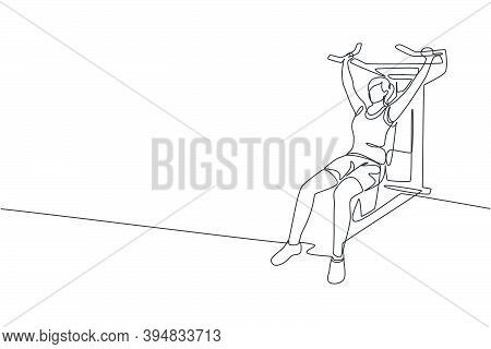 Single Continuous Line Drawing Of Young Sportive Woman Training With Hammer Strength Machine In Spor
